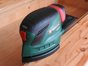 Sander and Wood Dust